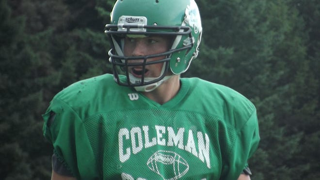 Coleman senior Blake Margis gets set to line up on defense during a scrimmage Friday at Algoma. The Cougars are trying to repeat as M&O Conference champions.