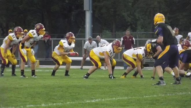 Luxemburg-Casco senior quarterback Jon Deprey gets ready to take a snap in a North Eastern Conference game at Denmark on Friday. Deprey rushed for 230 yards and two touchdowns in addition to passing for another TD.