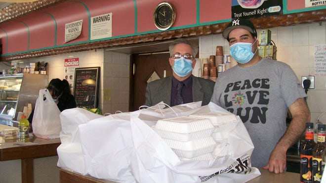 From left, Kiwanis Vice Pres. Robert Green and  Miss Monticello Diner co-owner Steve Nikolados. The Monticello Kiwanis Club, Tilly's Diner and Miss Monticello Diner provided lunches to healthcare workers.