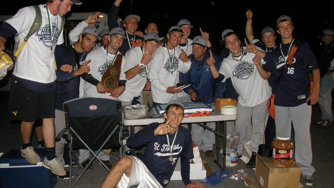 After beating Lebanon in 10 innings, 4-3, the St. Thomas Aquinas High School baseball team celebrates the 2012 Division II state championship, capping a 19-1 season. Along the way, the Saints snapped Portsmouth's national-record 89-game winning streak.