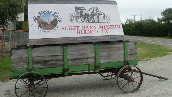 The sign out front lets visitors know they have arrived at the Buggy Barn Museum.