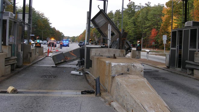 A Maine woman was hurt after her car crashed into a Route 16 northbound toll booth in Rochester Sunday afternoon.