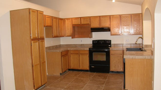 AFTER:  New appliances, flooring and lighting can add value.  photos by greg leach
