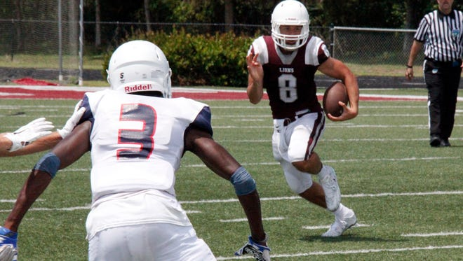 First Baptist Academy quarterback Julien Tirado runs downfield against Fort Lauderdale-Westminster Academy in the teams' spring football game at First Baptist Academy in Naples on Saturday, May 21, 2016.