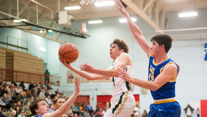 Catholic's Luke Smith, center, attempts to score against Christian Academy's John Ogle, left, and Cole Smith in the Region 2-AA championship game Thursday at Austin-East High School.