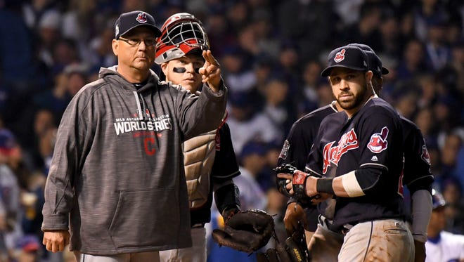 Cleveland Indians manager Terry Francona signals for Andrew Miller in the fifth inning of WOrld Series Game 4.