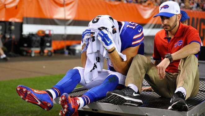 Buffalo Bills wide receiver Chris Hogan, left, is carted off the field after an injury in the first quarter of an NFL preseason game against the Cleveland Browns on Aug. 20, 2015.