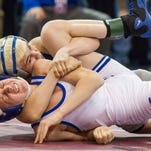 Roy Costello of Richmond attempts to get Dan Jaworski of Dundee to his back in the Division 3 State Championship Final.