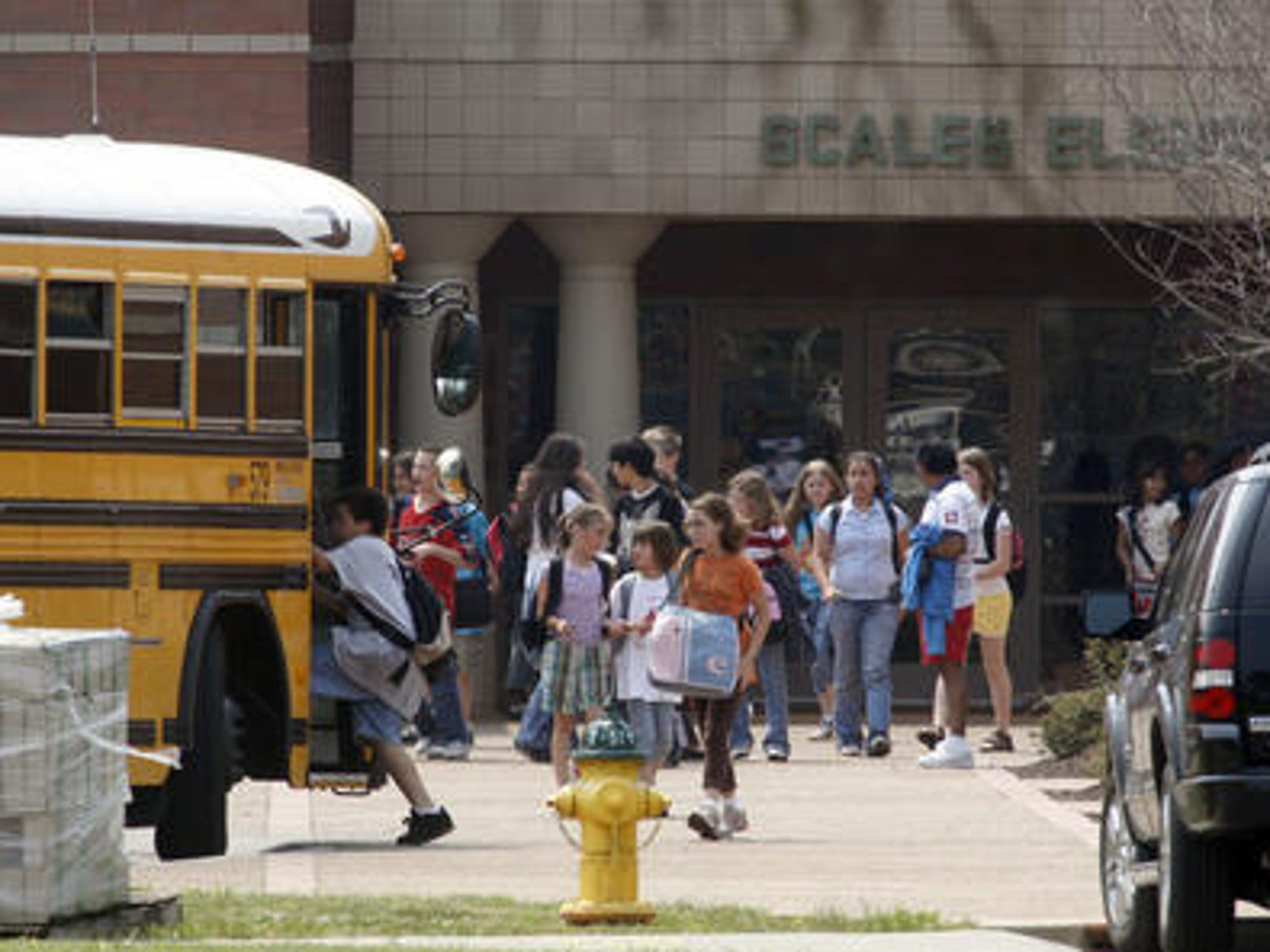 This file photo shows students at Scales Elementary School leaving the campus at dismissal time.