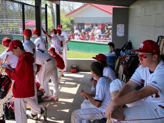 Port Huron players watch their game against La Salle at the Reid Rizzo Tournament.