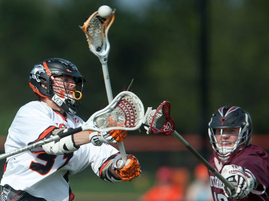 Lacrosse Division III quarterfinals RIT vs. Union College: Left, RIT's Alec Sulesky shoots before a block from Union's Tanner Jones in the second quarter.