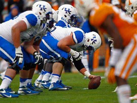 Kentucky center Jon Toth (72) prepares to snap the ball during an NCAA college football game against Tennessee Nov. 15, 2014 in Knoxville, Tenn.