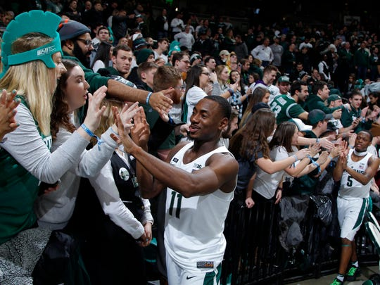 Michigan State's Tum Tum Nairn celebrates with fans after their defeat of Purdue.
