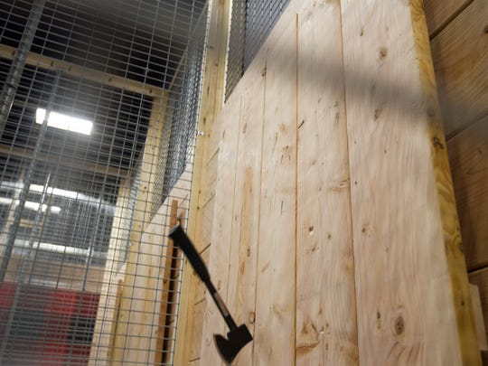 An ax bounces off of a target inside Hatchet Jack's along Highway 1 in Iowa City on Wednesday, June 27, 2018. The new ax-throwing bar is set to open soon.