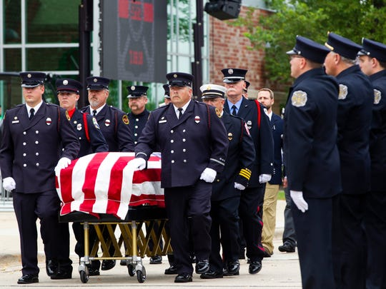 Members of the Sun Prairie Fire Department lead Capt. Cory Barr's casket to the front entrance of Sun Prairie High School, where his funeral was held on Saturday. Barr died in an explosion Tuesday in downtown Sun Prairie.