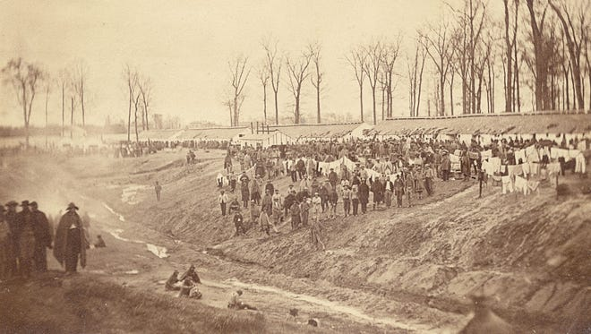 Camp Morton was named for Indiana Gov. Oliver P. Morton and housed captured confederate prisoners of the Fort Henry and Fort Donelson battles.  The first prisoners arrived by train in Feb. 1862.  In the 25 months of operation it is estimated that nearly 9,000 prisoners passed through the gates and deaths totaled 1,763 by the end of the war.