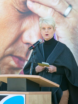 "Cindy McCain speaks about the anti-human trafficking campaign, ""Not Worth It"" in front of a billboard in Phoenix on Monday, November 9, 2015."