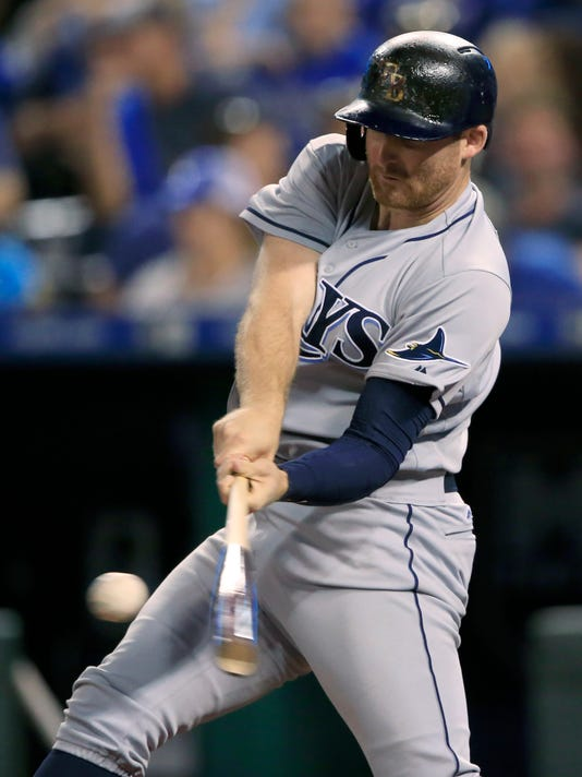 Tampa Bay Rays' Brad Miller hits a solo home run during the seventh inning of a baseball game against the Kansas City Royals at Kauffman Stadium in Kansas City, Mo., Tuesday, Aug. 29, 2017. (AP Photo/Orlin Wagner)