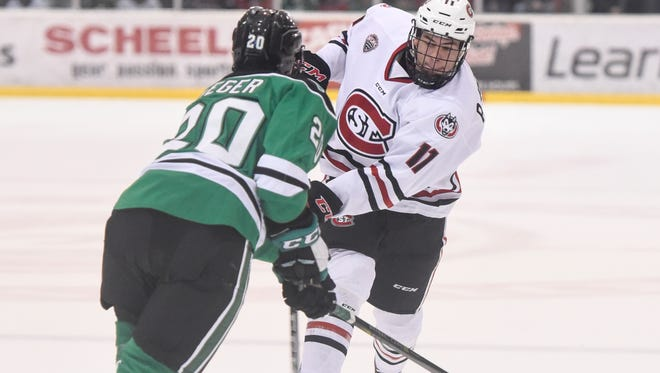 St. Cloud State's Ryan Poehling skates with the puck during the Friday, Dec. 8, game at the Herb Brooks National Hockey Center in St. Cloud.