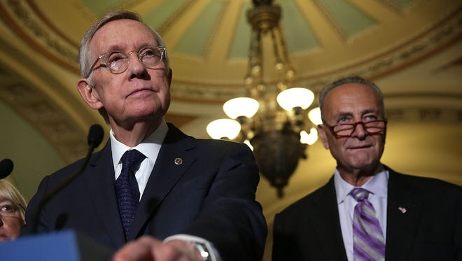 Senate Minority Leader Harry Reid, D-Nev., speaks to reporters with Sens. Patty Murray, D-Wash., and Chuck Schumer, D-N.Y.