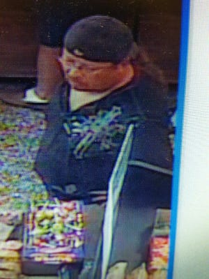 Police are looking for this man who they say stole a credit card and used it several times.