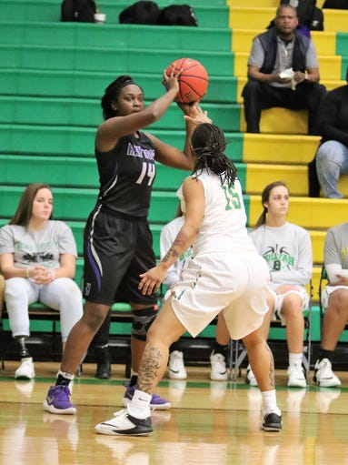 Haywood's Laquita Callaway looks to pass the ball during