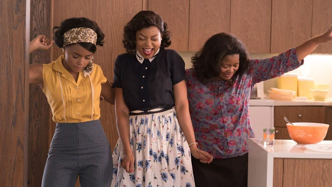 Mary Jackson (Janelle Monáe, left), Katherine Johnson (Taraji P. Henson) and Dorothy Vaughan (Octavia Spencer) take time to dance in the period drama 'Hidden Figures.'
