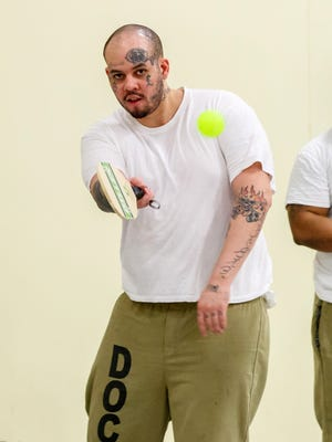 Inmate Ryan Ratliff (left) of Chicago plays in a pickleball match at the Cook County Jail.