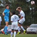 Cape Henlopen holding midfielder Zack Gelof (14) knocks in a header against Indian River on Tuesday evening in Dagsboro.