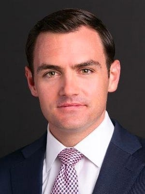 Mike Gallagher, a former foreign policy aide to Gov. Scott Walker's presidential campaign, won election to the 8th Congressional District seat.