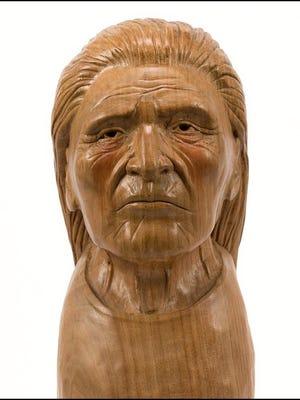"""""""Jon Williams, Weeping Eyes,"""" carved wood."""