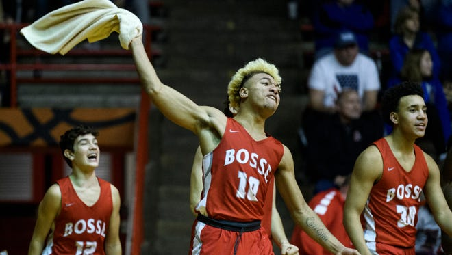 Bosse's Javen Layne (10) reacts to his team's widening lead over the Silver Creek Dragons during the IHSAA Class 3A Regional Championship at Memorial Gym in Huntingburg, Ind., Saturday, March 10, 2018. The Bulldogs claimed the regional championship title after defeating the Dragons, 81-55.
