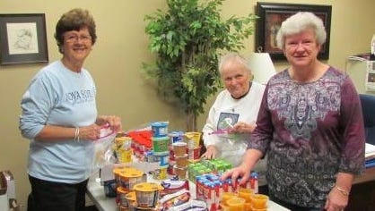 Phyllis Butt, Joann Manning and Martha Bowen from Parkway Baptist Church pack at ATLAS bags for Rutherford County students.