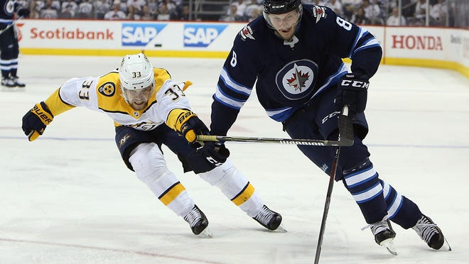 Jacob Trouba, right, has been teammates with Jets forward Andrew Copp during travel hockey and collegiately at Michigan.