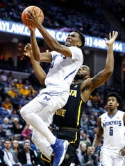 Memphis guard Jeremiah Martin (left) drives for a lay up against the Wichita State defense during second half action at the FedExForum in Memphis Tenn., Tuesday, February 6, 2018.