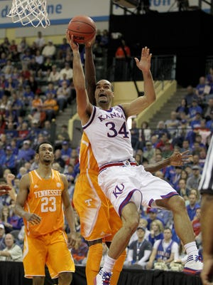 Kansas forward Perry Ellis (34) shoots in front of Tennessee forward Willie Carmichael III and forward Derek Reese (23).