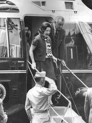 President and Lady Bird Johnson descend from a helicopter after returning to Glassboro State College for the Hollybush Summit on June 25, 1967.