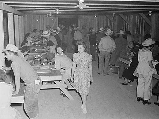 Evacuees of Japanese ancestry register upon arrival
