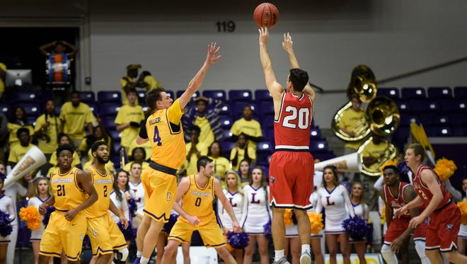 Belmont guard Taylor Barnette (20) shoots the game-winning shot over Lipscomb guard Cam Miller (4) in the final seconds of overtime to win 78-76 at Allen Arena Tuesday Dec. 6, 2016, in Nashville, Tenn.