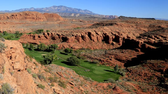 The Dixie Red Hills Golf Club and an historic sandstone quarry (bottom right) are both visible from the Owens Loop Trail in the Red Cliffs Desert Reserve above downtown St. George.