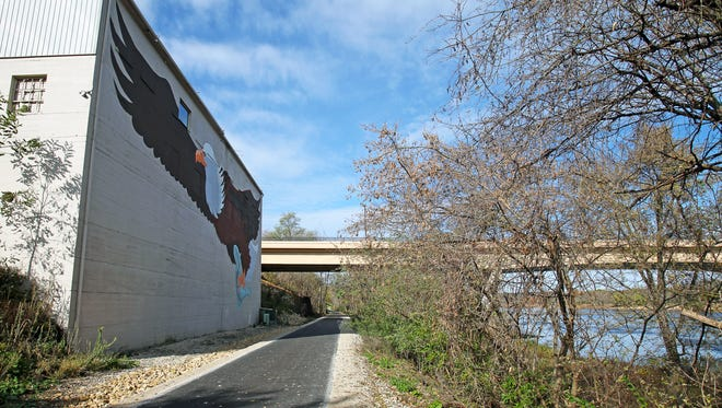 The Great Sauk State Trail passes by an eagle mural along the Wisconsin River in Prairie du Sac.