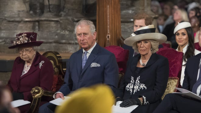 Queen Elizabeth II, Prince Charles, his wife Camilla, Duchess of Cornwall, Prince Harry and Meghan Markle at the Commonwealth Service at Westminster Abbey on March 12, 2018 in London.