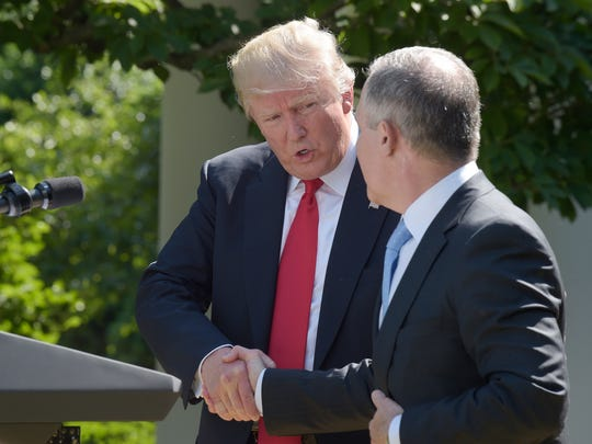 President Donald Trump shakes hands with EPA Administrator