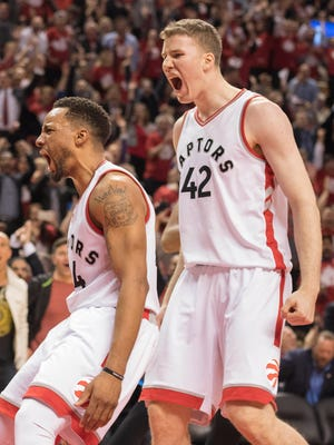 Toronto Raptors guard Norman Powell and center Jakob Poeltl celebrate a basket during the fourth quarter in Game 5 of the first round of the 2017 NBA Playoffs.