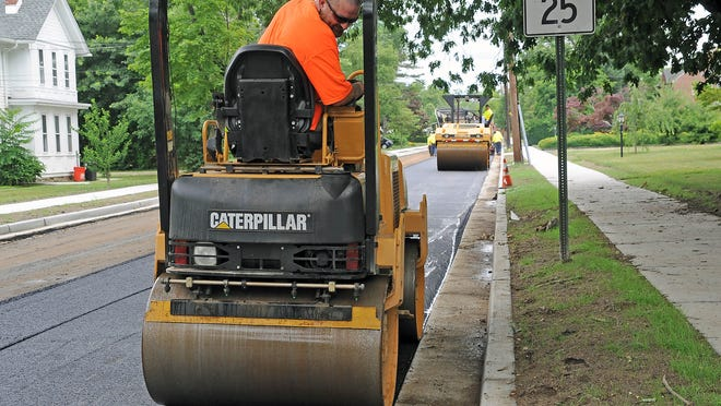 Frank Harte of South State in Bridgeton helps pave Elmwood Avenue in Vineland on Thursday morning.