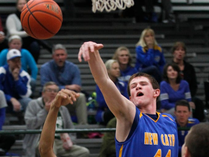 Trinity High School's Michael Stafford (30) fights for the rebound with Newport Central Catholic's Ben Weyer (44) during the first half of play at Trinity High School in Louisville, Kentucky.        February 18, 2014