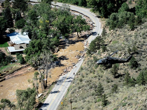 A rescue helicopter flies over Lyons, Colo., on Sept. 17, 2013.
