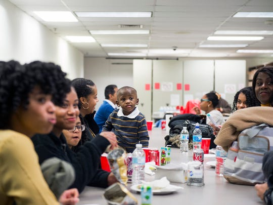 Caleb Gonzalez, 2, sits at a table with his new family, including five sisters Friday, Nov. 17, 2017 at the Camden County Surrogate's Office in Camden.