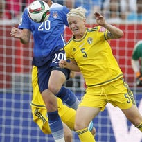 The United States' Abby Wambach, left, and Sweden's Nilla Fischer vie for the ball during Friday's scoreless tie.