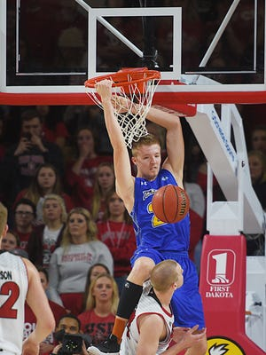SDSU's Reed Tellinghuisen dunks against USD during the game Wednesday, Jan. 24, in Vermillion.